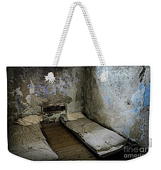 Weekender Tote Bag featuring the photograph An Empty Cell In Cork City Gaol by RicardMN Photography