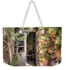 Weekender Tote Bag featuring the photograph An Entrance In Santorini by Tom Prendergast