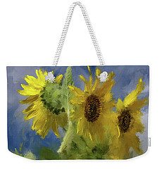 Weekender Tote Bag featuring the photograph An Impression Of Sunflowers In The Sun by Lois Bryan