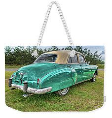 Weekender Tote Bag featuring the photograph An Old Chevy By The Road In Rural Maine by Guy Whiteley