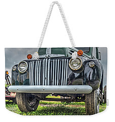 Weekender Tote Bag featuring the photograph An Old Green Ford Truck by Guy Whiteley
