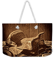 An Old Saddle Weekender Tote Bag by American West Legend By Olivier Le Queinec