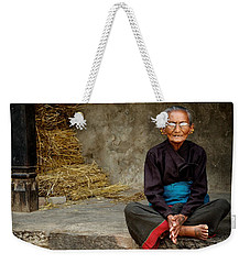 An Old Woman In Bhaktapur Weekender Tote Bag by Valerie Rosen