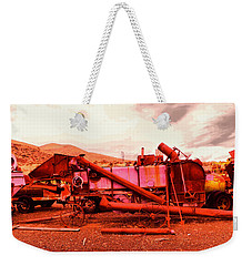 Weekender Tote Bag featuring the photograph An Old Rusty Harvestor by Jeff Swan