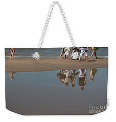Weekender Tote Bag featuring the photograph And So They Followed by Ana Mireles