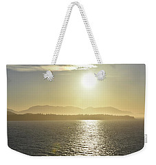 Weekender Tote Bag featuring the photograph And The Sun Goes Down by Melissa Lane