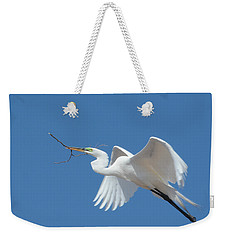 Weekender Tote Bag featuring the photograph Angel In Flight by Fraida Gutovich