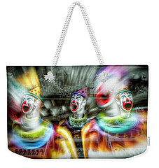 Weekender Tote Bag featuring the photograph Angry Clowns by Wayne Sherriff