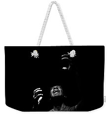 Weekender Tote Bag featuring the photograph Anguish by Eric Christopher Jackson