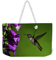 Weekender Tote Bag featuring the photograph Anna's Hummingbird With Fox Glove Flowers by Lara Ellis