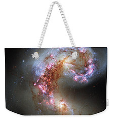 Weekender Tote Bag featuring the photograph Antennae Galaxies Reloaded by Nasa