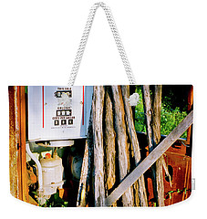 Weekender Tote Bag featuring the photograph Antique Gas Pump by Linda Unger