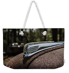 Weekender Tote Bag featuring the photograph Antique Hood Ornament by Kim Hojnacki