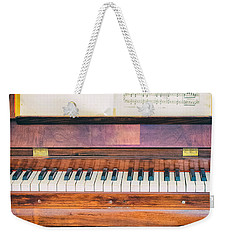 Weekender Tote Bag featuring the photograph Antique Piano And Music Sheet by Silvia Ganora