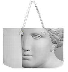 Weekender Tote Bag featuring the photograph Antique Sculpture by Andrey  Godyaykin