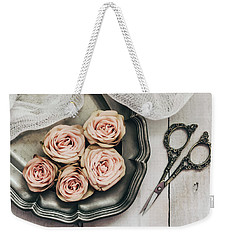 Weekender Tote Bag featuring the photograph Antiqued Roses by Kim Hojnacki