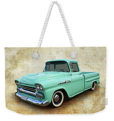 Weekender Tote Bag featuring the photograph Apache by Keith Hawley