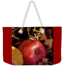 Apple In The Leaves Weekender Tote Bag