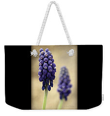Weekender Tote Bag featuring the photograph April Indigo by Chris Berry