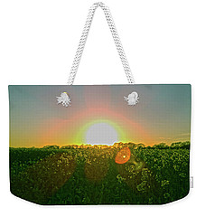 Weekender Tote Bag featuring the photograph April Sunrise by Anne Kotan