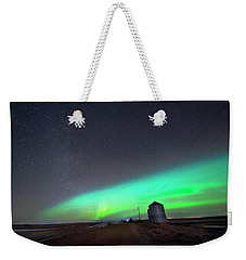 Weekender Tote Bag featuring the photograph Arc Of The Aurora by Dan Jurak