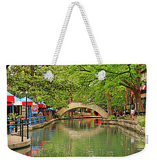 Weekender Tote Bag featuring the photograph Arched Bridge Reflection - San Antonio by Art Block Collections