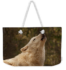 Weekender Tote Bag featuring the photograph Arctic Wolf Howling by Chris Flees