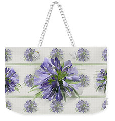 Weekender Tote Bag featuring the painting Blue Purple Flowers by Ivana Westin