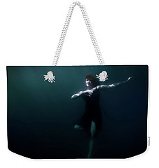 Weekender Tote Bag featuring the photograph Dancing Under The Water by Nicklas Gustafsson