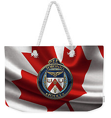 Weekender Tote Bag featuring the digital art Toronto Police Service  -  T P S  Emblem Over Canadian Flag by Serge Averbukh