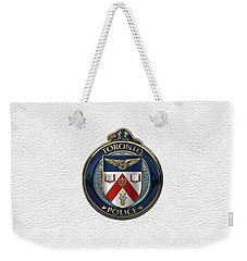 Weekender Tote Bag featuring the digital art Toronto Police Service  -  T P S  Emblem Over White Leather by Serge Averbukh