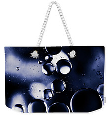 Weekender Tote Bag featuring the photograph deep purple blue tones Macro Water Droplets by Sharon Mau