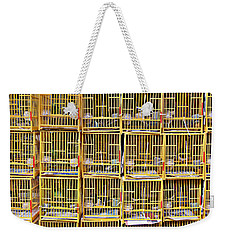 Weekender Tote Bag featuring the photograph Cagey by Ethna Gillespie