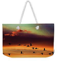 Sandhill Cranes Take The Sunset Flight Weekender Tote Bag