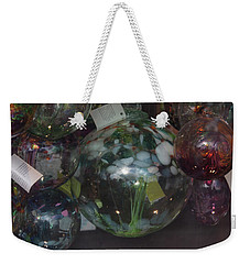 Weekender Tote Bag featuring the photograph Assorted Witching Balls by Suzanne Gaff