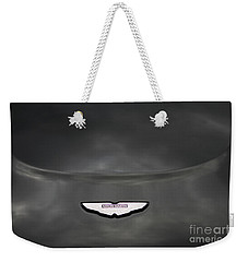 Weekender Tote Bag featuring the photograph Aston Martin by Mary-Lee Sanders