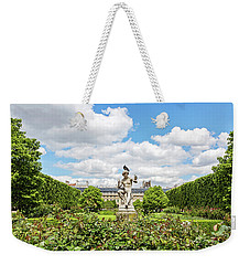 Weekender Tote Bag featuring the photograph At The Palais Royal Gardens by Melanie Alexandra Price