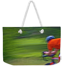 Weekender Tote Bag featuring the photograph At The Speed Of Light by Linda Unger