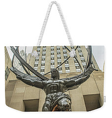 Weekender Tote Bag featuring the photograph Atlas Rockefeller Center by Timothy Lowry