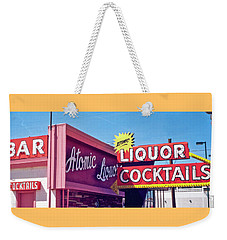 Weekender Tote Bag featuring the photograph Atomic Liquors by Matthew Bamberg