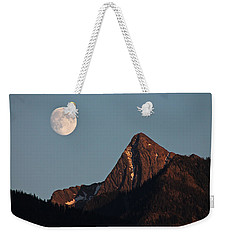 Weekender Tote Bag featuring the photograph August Moon Over Loki by Cathie Douglas