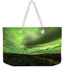 Aurora Borealis Over A Frozen Lake Weekender Tote Bag by Joe Belanger