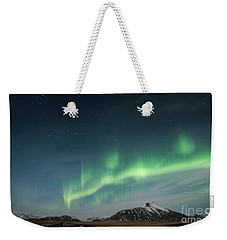 Weekender Tote Bag featuring the photograph Aurora Borealis Over Iceland by Sandra Bronstein