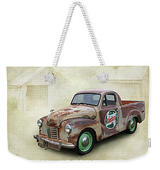 Weekender Tote Bag featuring the photograph Austin Ute by Keith Hawley