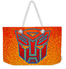 Weekender Tote Bag featuring the digital art Autobot Cracked by Justin Moore