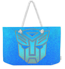 Weekender Tote Bag featuring the digital art Autobot Scales by Justin Moore