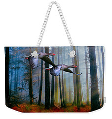 Weekender Tote Bag featuring the photograph Autumn Flight by Diane Schuster