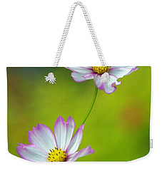 Weekender Tote Bag featuring the photograph Autumn Flowers by Byron Varvarigos