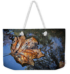 Weekender Tote Bag featuring the photograph Autumn Leaf by Debra and Dave Vanderlaan