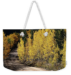 Weekender Tote Bag featuring the photograph Autumn Road by Jim Hill